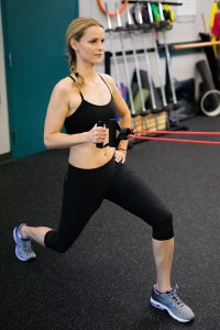 Attach a resistance band to a sturdy surface (around a bar or with a door stopper) and row while lunging.